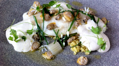 A delicate and elegant dish of fish with wild garlic.