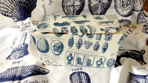 The glorious Rococo designs on my apron and chocolate box.