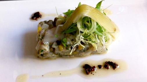 A zingy fish tartare featuring cacao pulp.