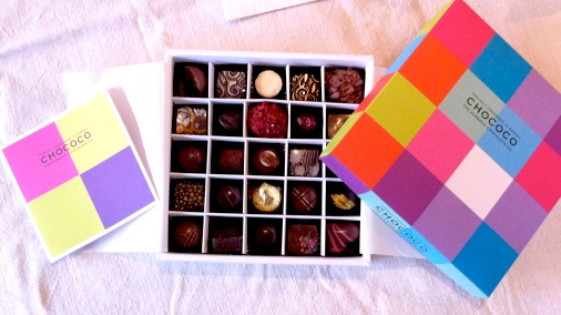 A box of Chococo's delicious fresh chocolates in their trademark colourful packaging.