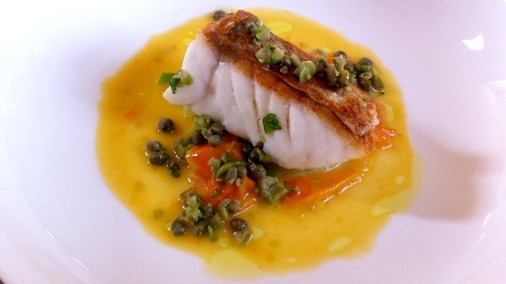 Roast hake with tomato and a green olive tapenade.