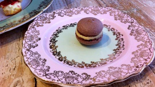 Chocolate macaron with pistachio filling.
