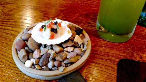 Raw scallop and caviar.