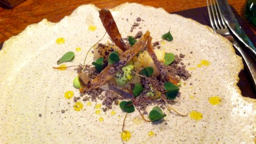 Potatoes in onion ashes, lovage and wood sorrel.