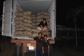 Arnaud in a truck full of his precious cacao.
