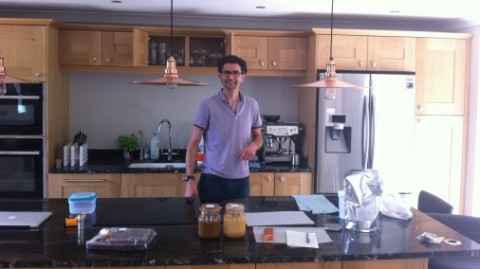 Chris in his shiny new chocolate kitchen.