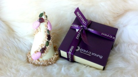Paul A Young's white chocolate tree with one of his signature purple boxes.